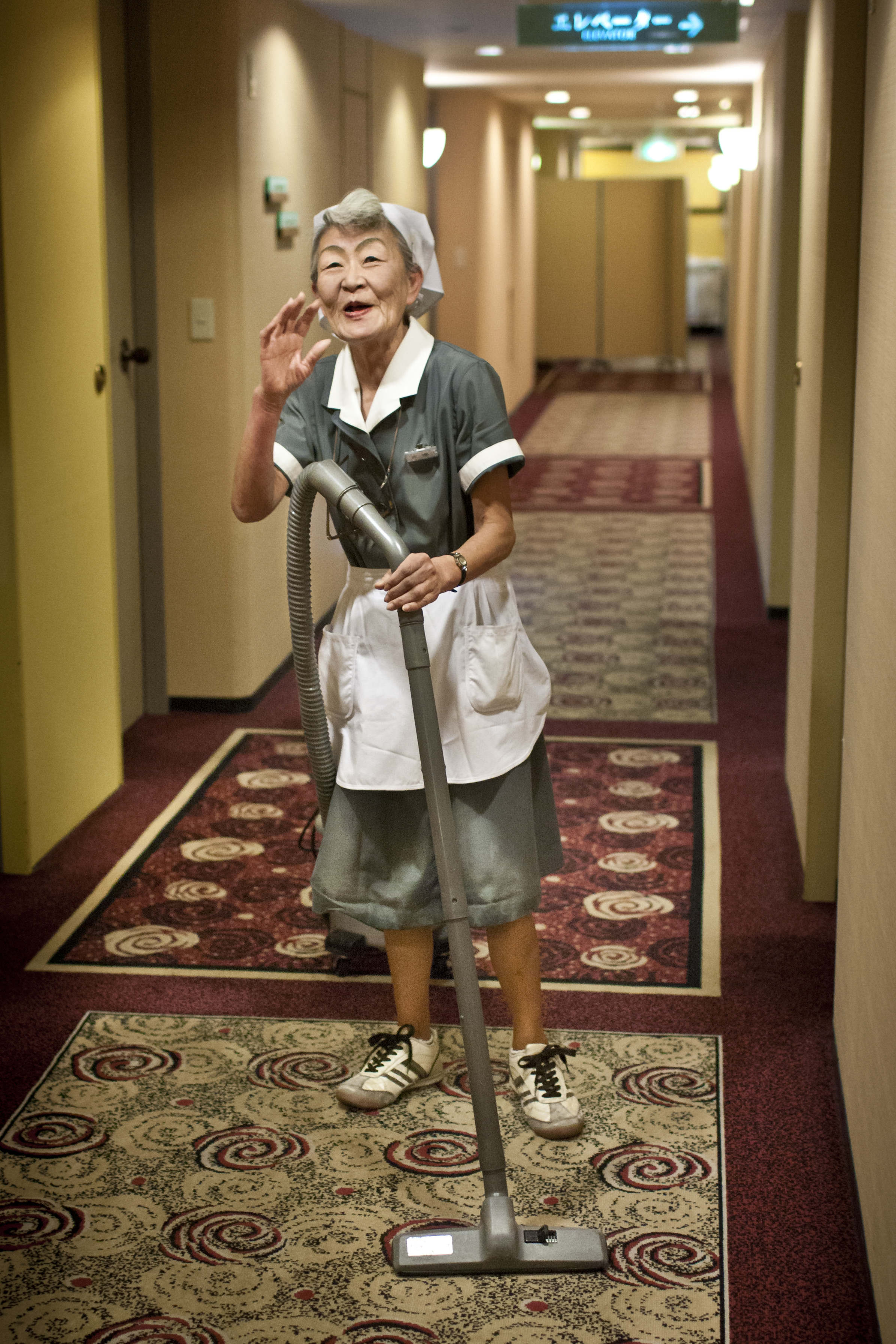 A hotel maid in hallway in Japan